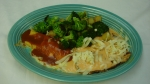 Pollo Oaxaca - 8 oz. grilled chicken breast topped with our chipotle sauce and cheese. Served with one cheese enchilada, a side of grilled broccoli, pineapple and a tossed salad.